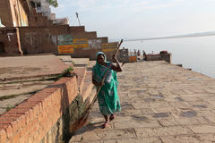 Varanasi. A woman sweeper cleans the ghat along the Ganger River or Ganga River in Varanasi, Uttar Pradesh, India Stock Photography