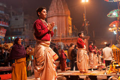 VARANASI: Young indian priests. Young indian priests Brahmins pray during the night ritual dedicated to the River Ganges in Varanasi Stock Photo