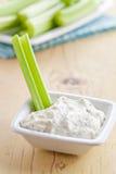 Varas de aipo verdes com mergulho saboroso Imagem de Stock Royalty Free
