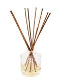 Varas do aroma em uma garrafa de vidro isolada Imagens de Stock