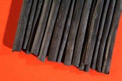 Varas pretas do carvão vegetal, fontes da arte. Foto de Stock