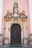 Varazdin cathedral details. Historic Varazdin cathedral massive carved wooden doors and main front entrance details Royalty Free Stock Photography