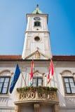 Varazdin city hall. With clock tower and three flags on balcony, Croatia Stock Image