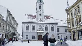 Varazdin square King Tomislav. VARAZDIN, CROATIA - FEBRUARY 07, 2015 The old building with a clock tower which includes the mayor`s office and city council on stock video