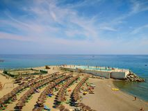 Varazze, Italy - People relaxing and sunbathing on the beach royalty free stock photography
