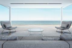 Vardagsrum i strandhuset, modern inre med havssikt Arkivfoton