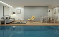 Vardagsrum, matsal och simbassäng i modernt hus Arkivfoto