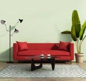 Vardagsrum med en röd soffa och en geometrisk filt Arkivfoto