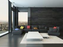 Vardagsruminre med den svarta soffan med kulöra kuddar Arkivfoton