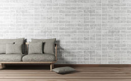 Vardagsruminre med soffa- och tegelstenväggen arkivbild
