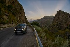 VARDZIA, GEORGIA - 06 AUGUST 2017: Driving mountain road at suns. VARDZIA, GEORGIA - 06 AUGUST 2017: Driving curvy scenic mountain route at sunset Stock Image