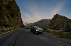 VARDZIA, GEORGIA - 06 AUGUST 2017: Driving mountain road at suns. VARDZIA, GEORGIA - 06 AUGUST 2017: Driving curvy scenic mountain route at sunset Stock Photo