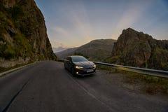 VARDZIA, GEORGIA - 06 AUGUST 2017: Driving mountain road at suns. VARDZIA, GEORGIA - 06 AUGUST 2017: Driving curvy scenic mountain route at sunset Royalty Free Stock Photos