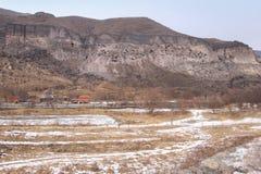 Vardzia in winter, Georgia. Vardzia is a cave monastery site in southern Georgia, excavated from the slopes of the Erusheti Mountain on the left bank of the Kura stock photos