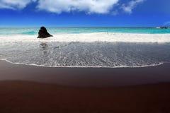 Vare la arena marrón negra del EL Bollullo y la aguamarina riega Foto de archivo