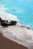 Vare la arena marrón negra del EL Bollullo y la aguamarina riega Imagen de archivo libre de regalías