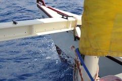 Varende Catamaran met gele zeilen in Ibiza Spanje Stock Fotografie
