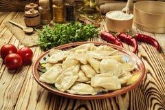 Vareniki dumplings, pierogi - traditional Ukrainian food,Cooke. D and served vareniki,pyrohy or dumplings, filled with potato and served with salty caramelized Royalty Free Stock Photo