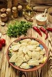Vareniki dumplings, pierogi - traditional Ukrainian food,Cooke. D and served vareniki,pyrohy or dumplings, filled with potato and served with salty caramelized Royalty Free Stock Image