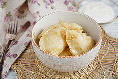 Vareniki with onion and sour cream Stock Images