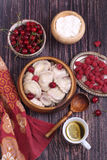 Vareniki with a stuffing from fresh berries and tea with a lem Royalty Free Stock Photo