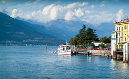 Varenna Ferry Port. Varenna, Italy - September 4th, 2015: people embarking on a white ferry in Varenna, a resort town near Lake Como in North Italy Stock Photography