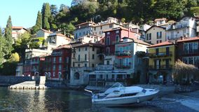 Varenna, Italy - November 15, 2017: scenic view of Varenna little town with speedboat moored on Lake Como. Italy stock video
