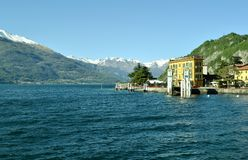 Varenna pier, lakefront and mountains covered with snow. Royalty Free Stock Photos