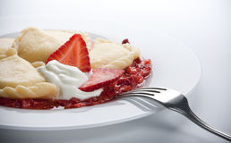 Varenyky with strawberry sauce Royalty Free Stock Images