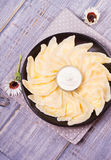 Varenyky, vareniki, pierogi, pyrohy or dumplings, filled with sweet cottage cheese farmer cheese and served with sour cream Stock Image
