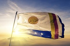 Varga State of Venezuela flag textile cloth fabric waving on the top sunrise mist fog. Beautiful royalty free stock image