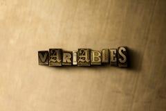 VARIÁVEIS - close-up vintage sujo da palavra typeset no contexto do metal Imagem de Stock