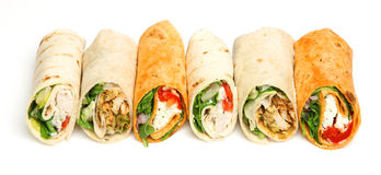 Variété de sandwichs à enveloppe sur le blanc photos stock