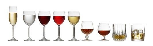 Variété de verres sur le fond blanc Photo libre de droits