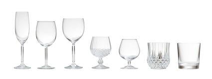 Variété de verres vides sur le fond blanc Photo stock