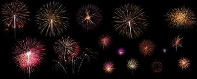Vari fuochi d'artificio variopinti isolati su fondo nero Immagini Stock Libere da Diritti