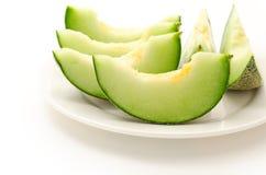 Vari hanno tagliato il melone Immagine Stock