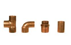 Vari montaggi di rame dell'impianto idraulico Fotografia Stock