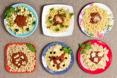 Vari piatti della pasta con i contorni Immagine Stock