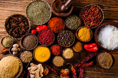 Variability of Asian spices on wooden table Royalty Free Stock Photos