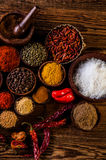Variability of Asian spices on wooden table Stock Photos