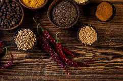 Variability of Asian spices on wooden table Royalty Free Stock Photo
