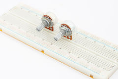 Variable Resistor on Protoboard. 2 variable resistor on protoboard with white blackground Royalty Free Stock Image