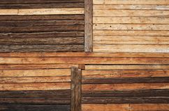 Rustic wooden log wall. Variable rustic wooden log wall background texture royalty free stock photography
