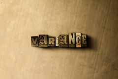 VARIANCE - close-up of grungy vintage typeset word on metal backdrop Stock Photography