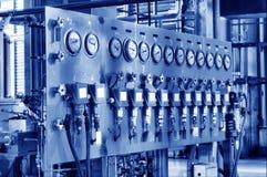 Varias filas de los metros eléctricos y de gas en el lado Fotografía de archivo libre de regalías