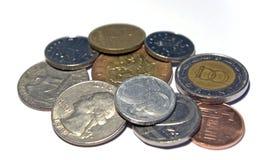 Varias monedas aisladas imagen de archivo