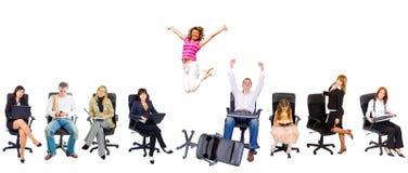 Varias personas en sillas de la oficina Imágenes de archivo libres de regalías