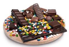 Variatie van donkere chocolade en snoepjes Stock Foto