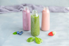 Variaties of Fresh and Cold Smoothies in Bottles Royalty Free Stock Photography